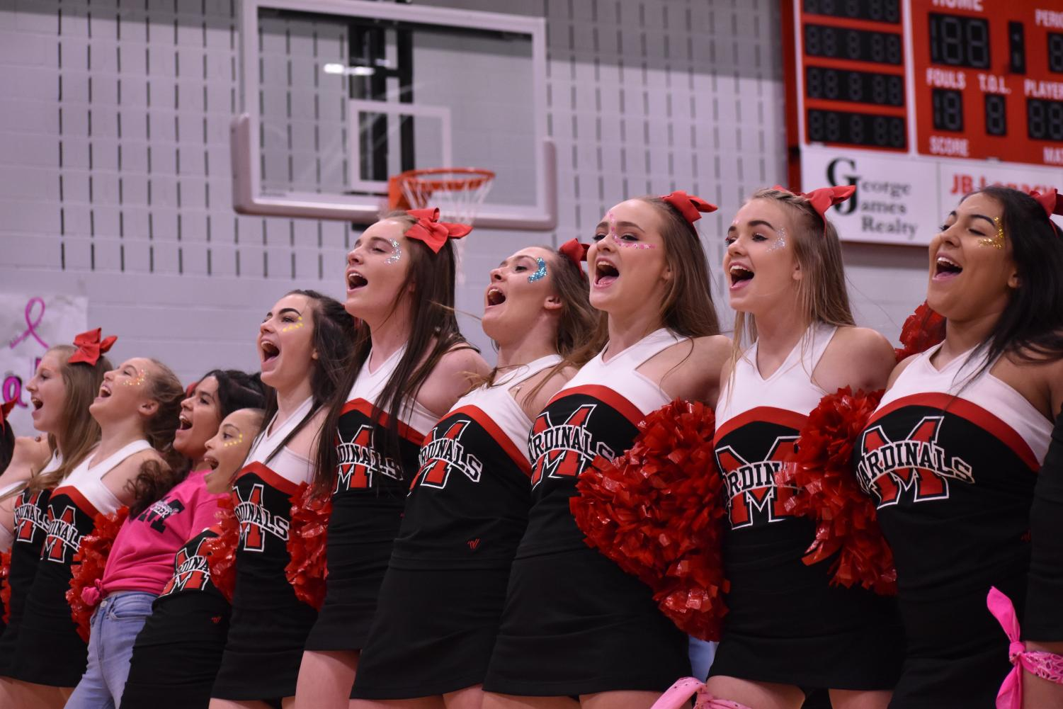 The cheer team leads the student body in Big Fatty.