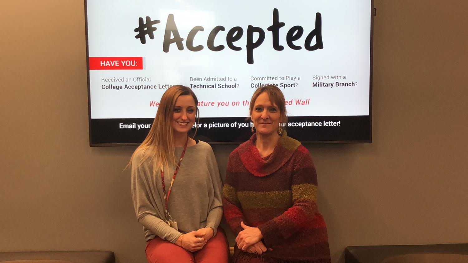 Counselors Ms. Gracy and Mrs. Chapman in front of the #accepted wall