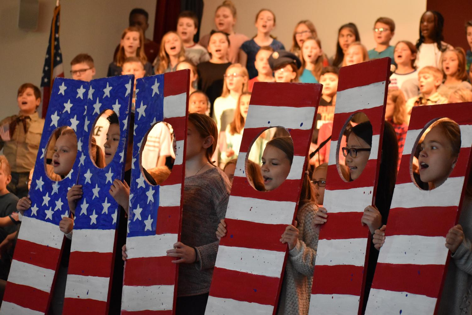 Fifth grade students perform God Bless America at their HME veterans day concert.