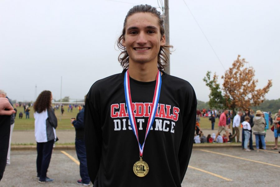 Junior+Judson+Greer+shows+off+his+first+place+medal%2C+which+qualifies+him+for+the+state+meet.