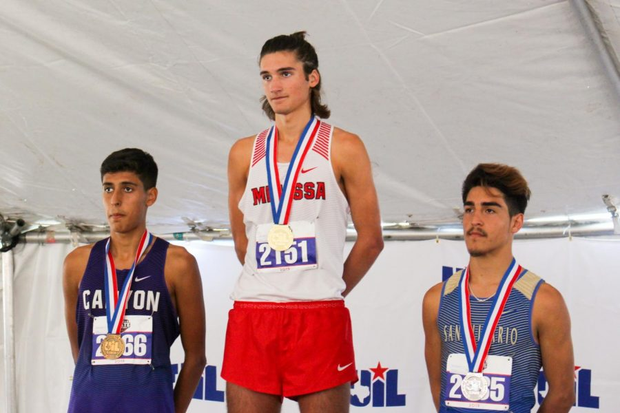 After being awarded his medal, Judson Greer (11), waits to be recognized.