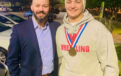Coach Kiefer and Haden Nofziger pose for a picture with Haden's state medal.