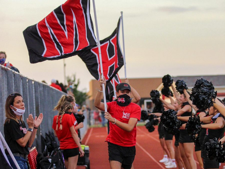 The flag runners display school pride for one of the many Cardinal touchdowns in their victory over Sunnyvale.