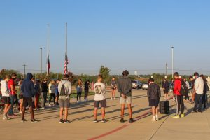 With flags flying half-mast to honor the passing of Chief Justice Ginsburg, students and faculty members gather early on Fri., Sept. 25, for fellowship and prayer. This annual event is sponsored by Fellowship of Christian Athletes (FCA).