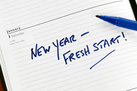 New Year resolution marked in a diary for 01 January