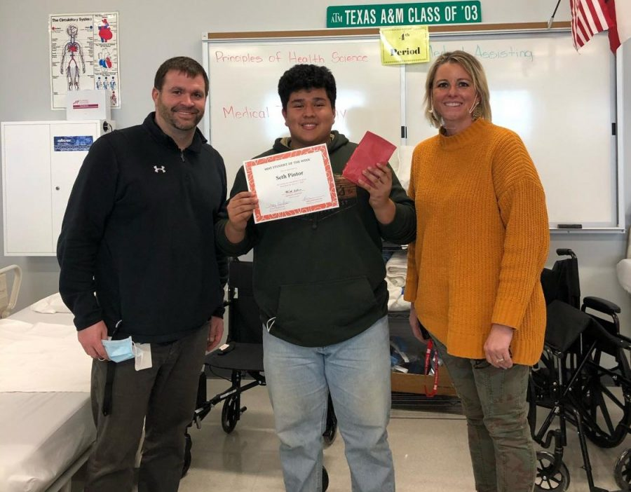 Junior Seth Pintor, pictured with Asst. Principal Stacy Needham and Academic Dean of Students Todd Pennington, is recognized as Cardinal of the Week.