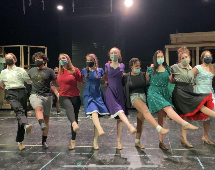 Cast members rehearse for their upcoming premier of musical in new performing arts center.