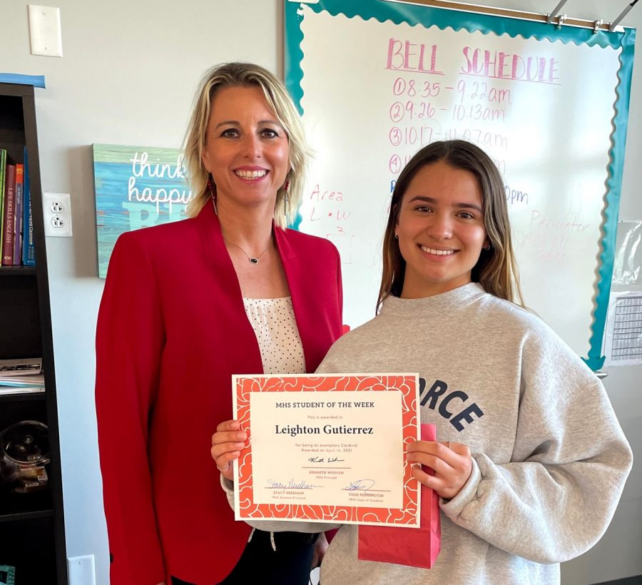 Asst. Principal Stacy Needham presents the Student of the Week award to soph. Leighton Gutierrez.