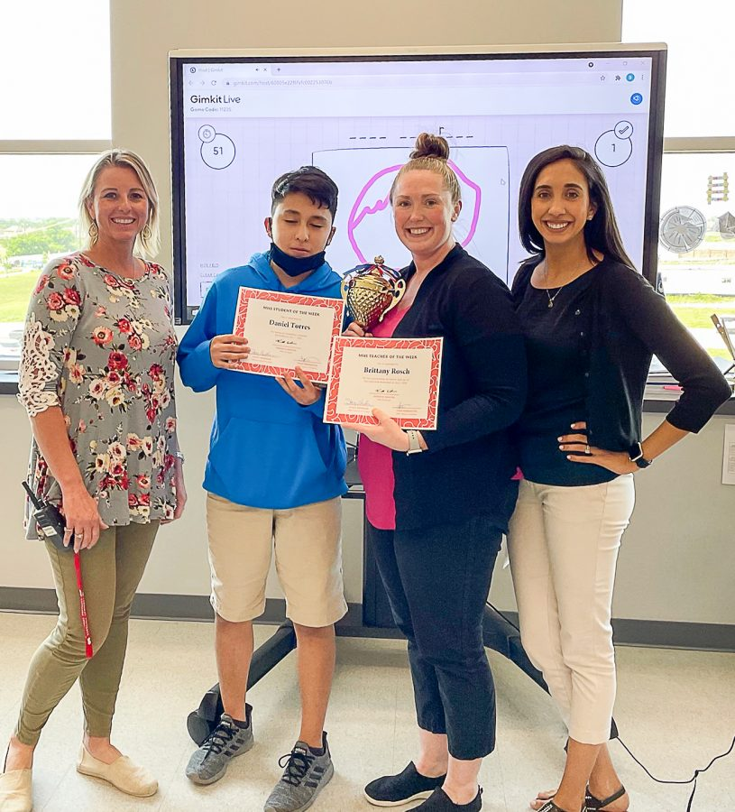 Assistant Principal Stacy Needham presents the Cardinals of the Week Awards to Daniel Torres and Brittany Rosch. Also pictured is Christina Pinckney, last week