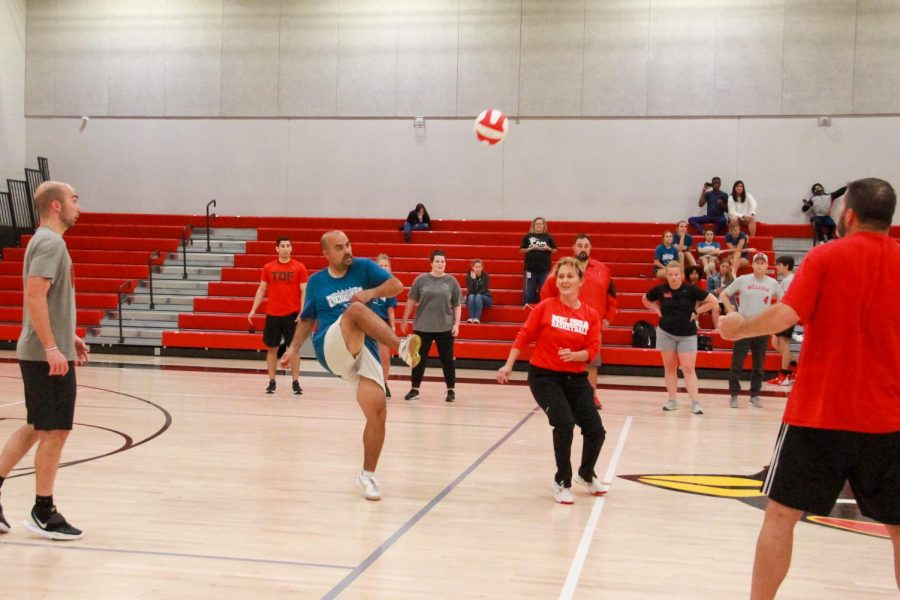Faculty members take on the winning senior team in a volleyball match during Field Day, May 21.
